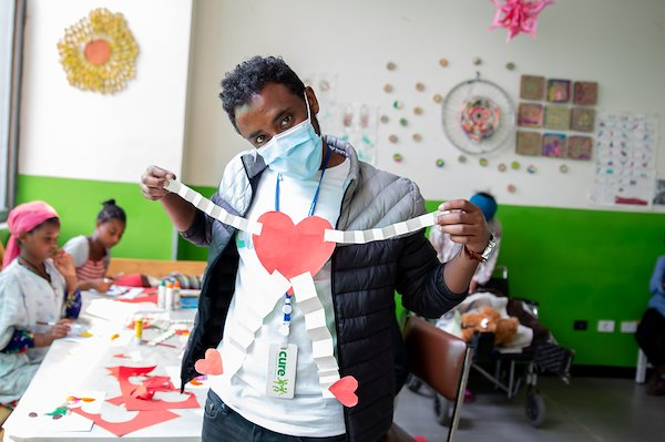 Our playroom specialist Temesgen helped the children make hearts.