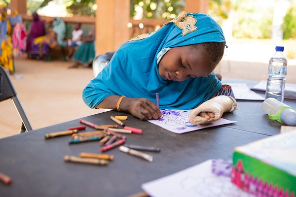 Souraya got to color and learn how God loves children while she waited for her appointment with the doctor.