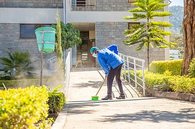 Peter is helping to keep our hospital compound clean.