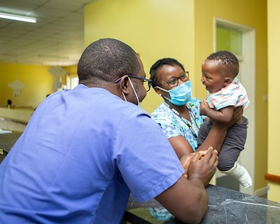 Nurses, Luyando and Mambwe, are having fun with a patient.
