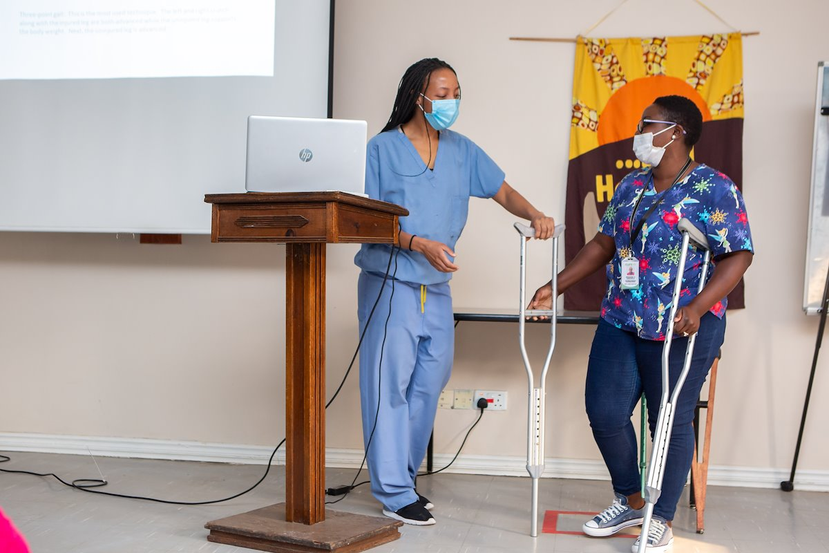 Physiotherapist Roxanne and Mweemba gave a presentation on how to properly use crutches.