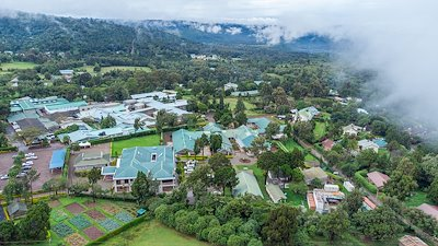 An aerial perspective of CURE Kenya on a foggy day.