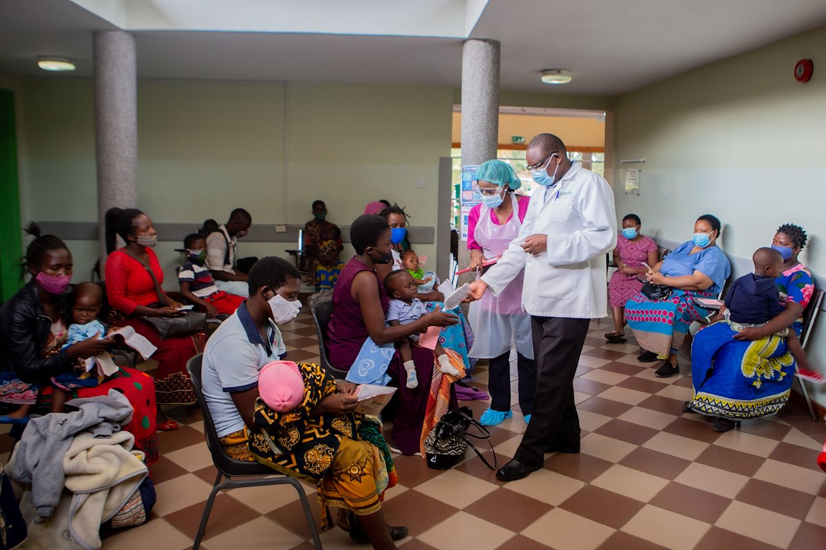 Dr. Maina and a nurse screening patients.