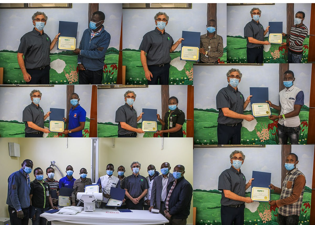 Certified BioMed trainees receive their certificates.