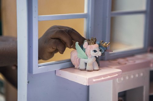 Patients playing with unicorns in the playroom.