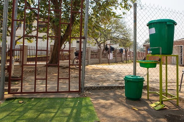 At every entry gate, there is a cleaning area. This big bucket is filled with chlorine water to disinfect people that enter the CURE premises.