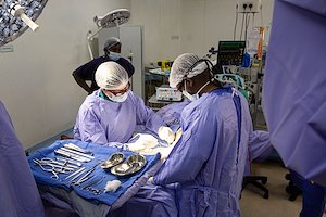Dr. Rick and Nurse Philani deep in concentration during surgery.