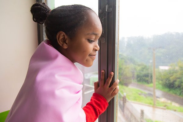 Meriyem shelters inside from the cold and wet Ethiopian rainy season
