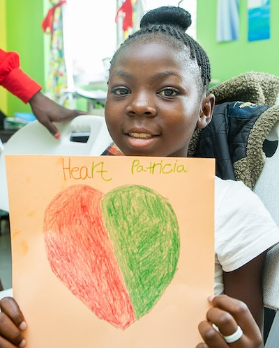 We asked kids to draw hearts to symbolize love. Patricia's heart drawing is beautiful, just like her!