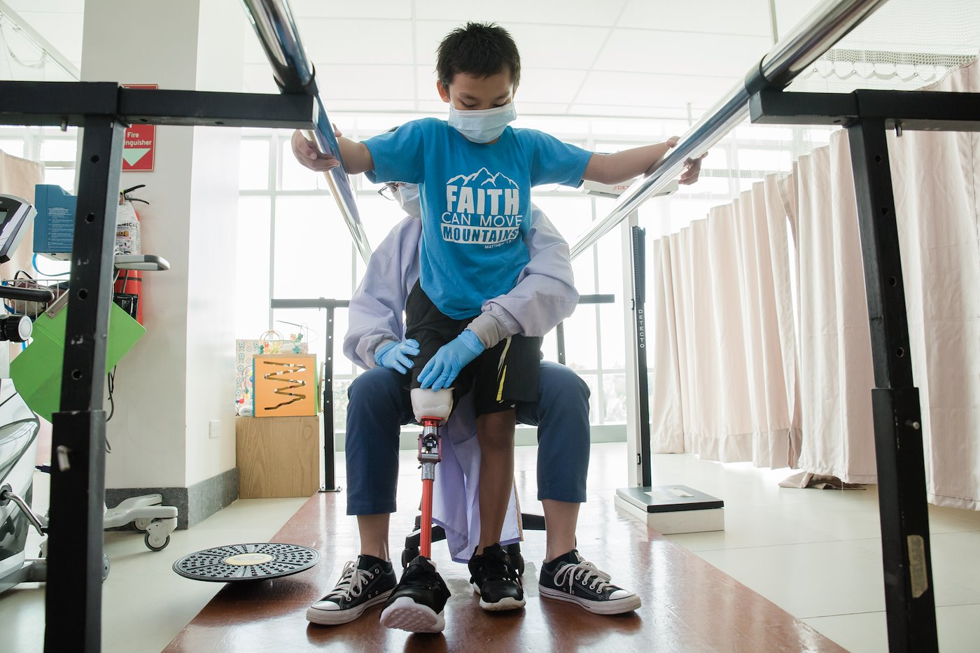 Wilson practices how to walk with his new prosthetic leg.