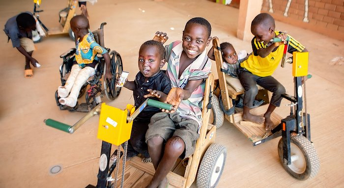 Issoufa and his friends enjoying tricycle rides.