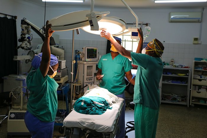 Setting up lights for a surgery.