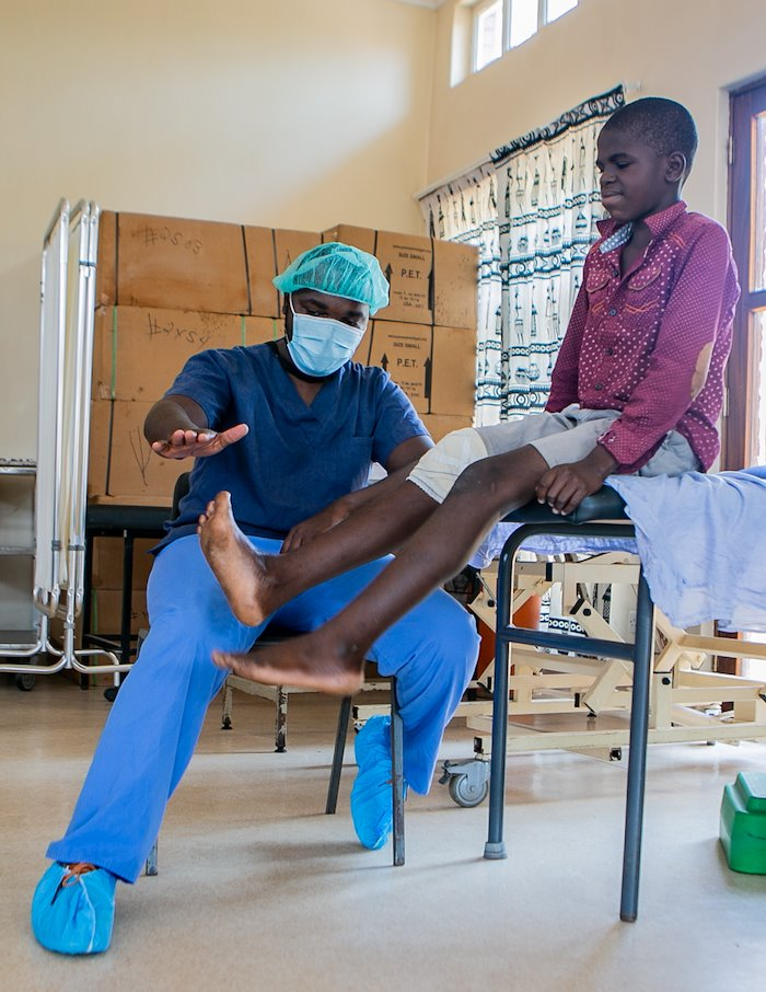 Our physical therapy team is helping Noel to properly bend his leg after receiving surgery.